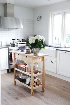 Small freestanding kitchen island. Our kitchen will not have an island... and after nine years of having an island, I kinda like the openne...