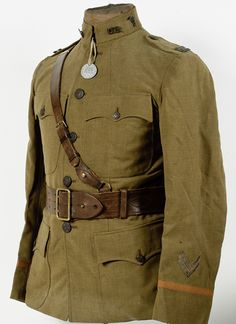 U.S. WWI Medical Officer's Tunic, Sam Brown Belt and Dog Tag Captain's four-pocket summer-weight tunic, officer's belt, and dog tags of Kenneth Glouse.