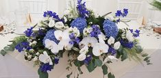 A beautiful blue top table arrangement for a gorgeous wedding at the Green Man. Delphiniums and hydrangeas finished beautifully with precious orchids Delphiniums, Hydrangeas, Wedding Bells, Wedding Flowers, Top Table Flowers, Table Arrangements, Green Man, Wedding Season, Flower Art