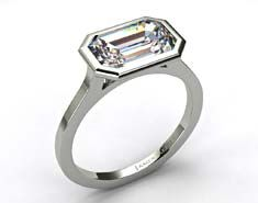 East West Emerald engagement ring in Tiffany look-alike bezel setting from James Allen Jewelers.
