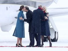 a couple of people that are standing in the snow: royal family norway
