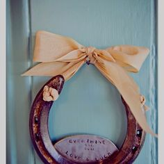 Horseshoe decoration. Could do something like this for her room!