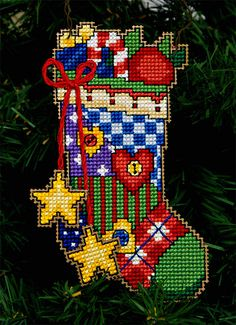 Homemade Christmas Ornament ~ Cross Stitched Stocking by stevetoearth. I would put it on Plastic Canvas instead. Cross Stitch Stocking, Xmas Cross Stitch, Cross Stitch Cards, Beaded Cross Stitch, Cross Stitching, Cross Stitch Embroidery, Cross Stitch Patterns, Plastic Canvas Christmas, Plastic Canvas Crafts