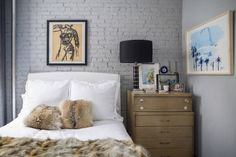 a tiny bedroom with gray walls