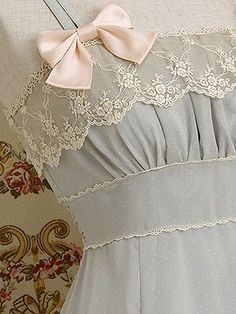 vintage how sweet and lovely art thou. With your little satin bows and lace trim, you make my heart swim in love