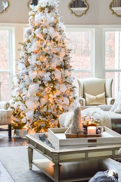 big-white-and-silver-and-gold-elegant-christmas-tree-in-white-great-room-living-area