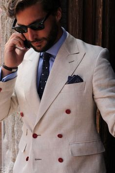 Men's Black Sunglasses Light Blue Dress Shirt Navy and White Polka Dot Tie Navy Print Pocket Square and Beige Double Breasted Blazer Cream Suit, Light Blue Dress Shirt, Madrid, Best Street Style, Mens Fashion Blog, Men's Fashion, Summer Suits, Double Breasted Blazer, Blazers For Men