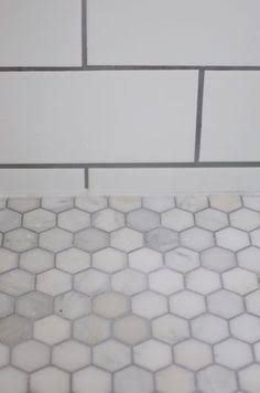White marble hexagonal tile with grout, Carrera marble floor tile white ceramic tile gray accent Source by LakeyshiaLemane Hexagon Tile Floor, Bathroom Redo, Flooring, Tile Floor, Bathrooms Remodel, Mosaic Backsplash Kitchen, White Marble Hexagon, Subway Tile Shower Designs, Hexagon Tiles