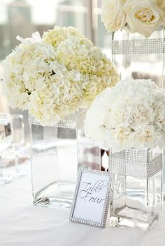 Glamorous white centerpieces by http://organicelements.com | Wedding planned by http://atfirstblushandco.com Photo by http://scottlawrencestudios.com