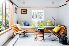 Small living space with matching leather armchairs, and a bench