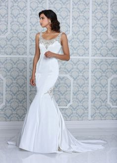 mermaid style wedding gown with embellishments by Impression Bridal #weddingdress #bridallook #weddingchicks http://www.weddingchicks.com/2014/03/11/impression-bridal-wedding-gowns/