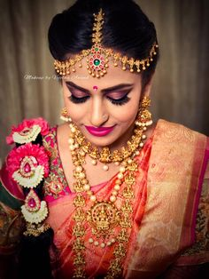 Sujitha is all dolled up for her muhurtam. Makeup and hairstyle by Vejetha for Swank Studio. Pink lips. Maang tikka. Statement necklace. South Indian bride. Eye makeup. Bridal jewelry. Bridal hair. Silk sari. Bridal Saree Blouse Design. Indian Bridal Makeup. Indian Bride. Gold Jewellery. Statement Blouse. Tamil bride. Telugu bride. Kannada bride. Hindu bride. Malayalee bride. Find us at https://www.facebook.com/SwankStudioBangalore