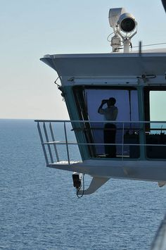 Watch as the crew keeps watch. The bridge of Navigator of the Seas extends out past the sides of the ship so that the vessel can be navigated within inches of the dock.