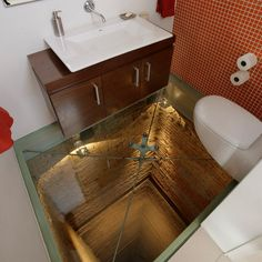 """A bathroom with a glass floor looking down an elevator shaft?  This is on my """"gotta-have"""" list."""