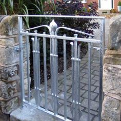 The detailing in this understated garden gate was inspired by the Arts and Crafts movement