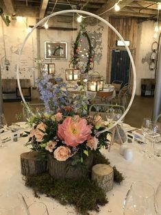 Low level floral hoop for a rustic feel with logs and moss. Dressed with peonies, roses and delphinium. Low level floral hoop for a rustic feel with logs and moss. Dressed with peonies, roses and delphinium. Floral Centerpieces, Wedding Centerpieces, Floral Arrangements, Wedding Decorations, Wedding Wreaths, Chic Wedding, Wedding Table, Rustic Wedding, Our Wedding
