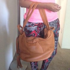 New brown bag Double full size pockets. Can be use as a backpack. Side pocket with fringe detail! New! Bags