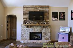 barn wood accent over fireplace