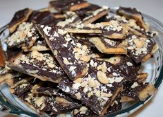 Cracker Candy 35-40 Saltines 2 sticks of salted butter -do NOT use margarine 1/4 cup sugar 1 bag of milk (or semi or dark) chocolate morsels Sliced almonds or any other nuts Line cookie sheet with foil (sides too). Lay saltines side by side in one layer, sides touching. Melt butter, add sugar and boil 3 minutes. Drizzle over crackers, (keep crackers together). Bake 5 minutes @ 400°. Remove from oven and sprinkle chocolate over baked crackers. They will start to melt – spread over crack