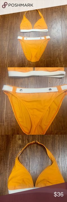 Orange and white belted bikini size 12 This bikini reminds me of the one Halle Berry war and 007! So cute. This is a size 12 and in excellent preowned condition no noticeable flaws. Top is a classic triangle style that hooks in the back behind the neck and back. Bottoms are full coverage with the Sassy belt. La Blanca Swim Bikinis