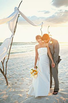 Super shot of wedding couple on beach in a great pose