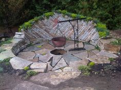 Just firebrick and stone to transform an outdoor area into a beautiful and welcoming fire-pit/outdoor cooking spot!