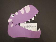 Home made dinosaur head invite.