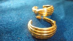 Swirl gold and rhinestone hoop earrings by PatsapearlsBoutique, $12.99