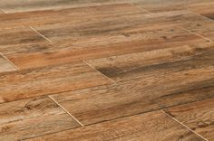 Porcelain tile to look like wood. Want a more ashy color, but like the warmth and texture of this one