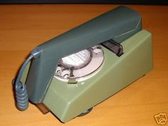 70s UK Trimphone. We had this exact same one; same colour too! We also had a party line for a while.