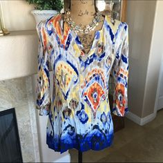 """🌷HP 4/18🌷Chico's  Ikat Print Summer Top Size 4/6 🌷Girly Girl Host Pick 4/18 by @autumnlynn03🌷 Please visit her gorgeous closet! This cute top from Chico's has the tags removed, but if it was worn I only wore it once. The print is so bright and fun for summer!! It has 3/4 length sleeves that can be rolled or pushed up, and a lightweight fabric! I'm calling this a tunic because it's longer than most of Chico's tops, but it's not very long. The bust measures approx 32"""" and the length 24""""…"""