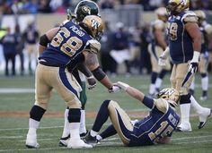WK 15 - 2015 - Eskimos 24 - - Winnipeg Blue Bombers  quarterback Matt  Nichols is assisted by Dominic Picard after getting hit hard by Edmont. 6ffcb5622