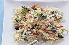 Broccoli florets, strips of pepper and sliced carrots bring punches of color to this delicious but quick lemon chicken and rice dish.