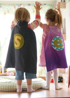 Super hero cape out of bed sheets.