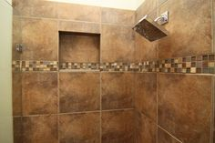 The cool-looking shower fixture was added to compliment the tub fixture in this Austin, TX Master bathroom remodel.