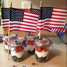 Red, white and blue snack! Blueberries, vanilla yogurt, and strawberries layered in small mason jars, with American flags tied on! My boys like to shake them up and cover the fruit in the yogurt before they dig in..
