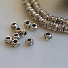 Om Beads, Hill Tribe Silver Ohm Beads, Karen Hilltribe Silver Beads,Ohm, Om, Aum,6x3mm, 2.5mm hole, Rondelle, Yoga, Meditation, Pack of 10 by WanderlustWorldArts on Etsy