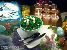Cake Wrecks - GreenBeans ala Frosting LOL actually I'm really loving the creativity of this display (hot cross bun-cupcakes and what I can only hope is a ham-cake with pineapples off to the right edge) :D