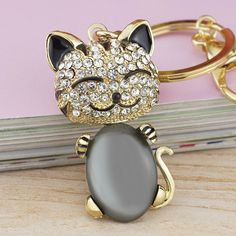 Check it out!!! Smile Cat Opals C... now available at http://happycatmeow.com/products/smile-cat-opals-crystal-enamel-handbag-keychain?utm_campaign=social_autopilot&utm_source=pin&utm_medium=pin