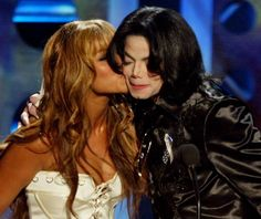 A girl kissing Michael Jackson