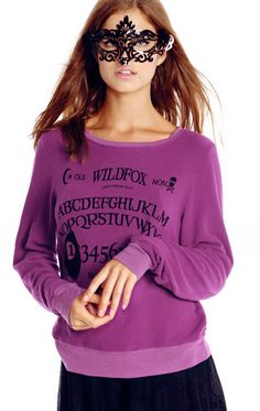Let's ask the Ouija board. This Halloween, dress up and play in this spooky jumper. Featuring a scoop neck, long sleeves with banded hems and a roomy, relaxed fit that hangs off the body perfectly. Our deliciously soft and distressed fleece blend.  47% Rayon, 47% Polyester, 6% Spandex