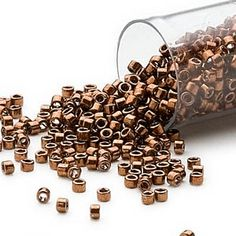 Seed bead, Delica, glass, nickel-finished copper, (DB461), #11 round. Sold per 7.5-gram pkg.