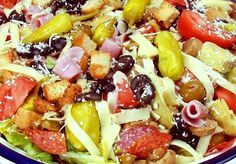 Antipasta Salad....just what I like lettuce, pepperoni, black & green olives, tomatoes, deli meats, pepperoncinis, onions, feta cheese, crutons, and wishing they had chickpeas added.