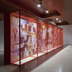 """This exhibition designed by Gitta Gschwendtner for London's Somerset House displayed fashion drawings on gauze-covered boxes."""