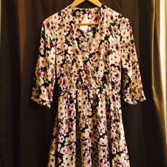 Beautiful floral dress Hundred percent polyester really cute with boots for the fall Dresses Midi