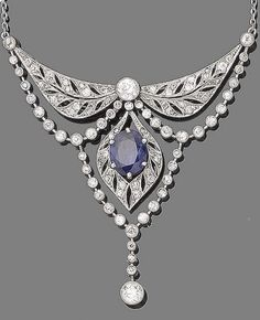 A Belle Epoque sapphire and diamond necklace, circa 1915. Set to the front with three pierced lozenge-shaped plaques, millegrain-set with old brilliant-cut and cushion-shaped diamonds, connected by similarly-set diamond swags, and centrally-set with an oval-cut sapphire, to a trace-link chain. #BelleÉpoque #necklace #antique