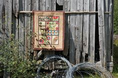 Brown leaf tapestry hanging over rail on side of old barn. Leaf Quotes, Country Scenes, Outdoor Settings, Wood Watch, Autumn Leaves, Indoor Outdoor, Barn, Tapestry, Art Prints