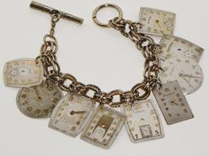 9 different vintage watch faces dangle from a gold tone bracelet and is secured by a large toggle clasp.