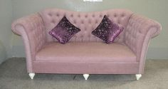 This is the pink fabric upholstery 3 seat sofa.