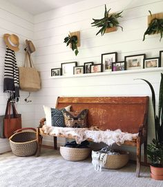 my scandinavian home: bench in the hallway of the cosy modern bohemian home of Megan Schlachtenhaufen